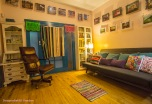 Frida Room: sitting room, with chair, large sofa, comfortable room. Wheelchair Accessible