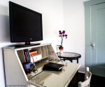 Sleeping Porch, television on white secretary desk.