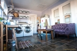 Washer and Dryer in Laundry Room with Shelving