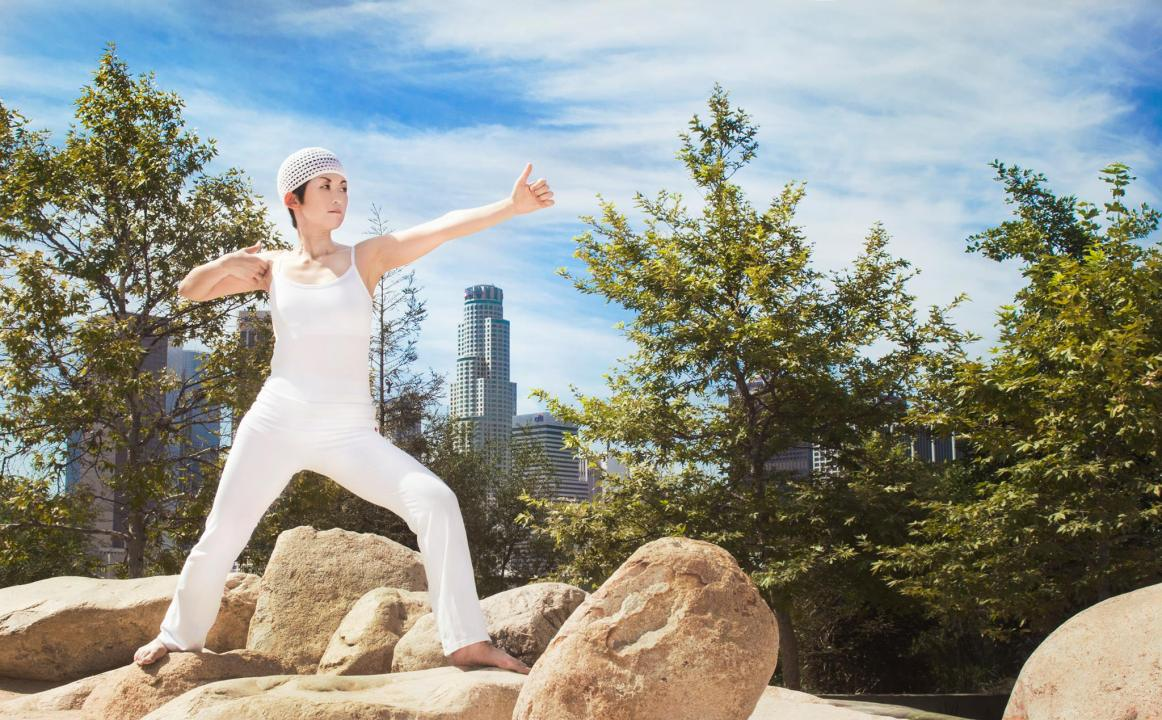 Misako Lauritzen in Yoga post with L.A. skyline