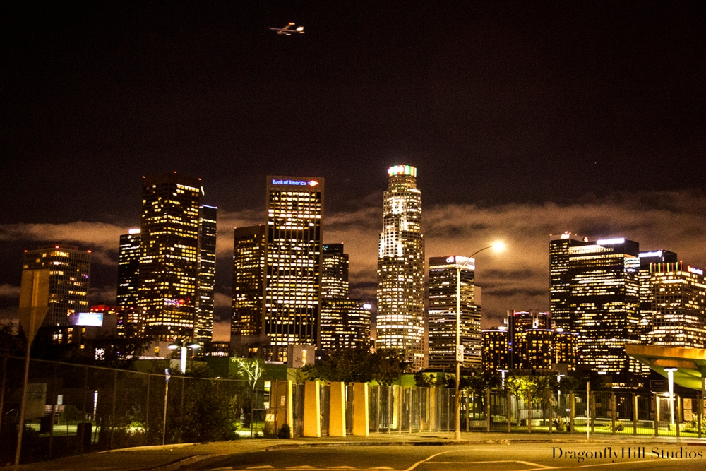 Flight over Los Angeles: Image of L.A. skyline downtown at night