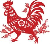 Intricate paper cut of a rooster, in red paper.