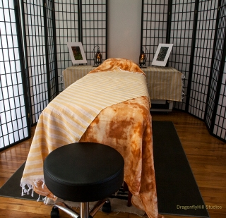 Reiki table with blankets in a comfortable reiki room