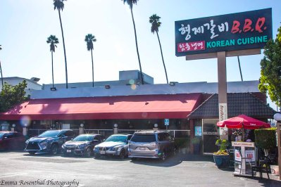 Parking lot and entrance way to Brothers Korean BBQ Restaurant.