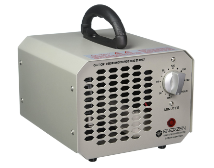 Enerzen Commercial Ozone Generator 6000mg Industrial O3 Air Purifier Deodorizer Sterilizer A small silver colored box with a timer dial, a handle a light and vent holes.